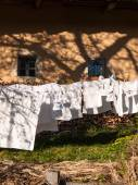 Clothes line full of laundry  — Stockfoto
