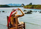 Girl  on   chair near  sea — Stock Photo