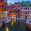 Narrow canal among old colorful brick houses in Venice — Stock Photo #58059109