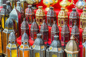 Row of shiny traditional coffee pots and lamps — Stock Photo