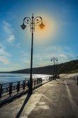 Street lights on promenade — Stock Photo