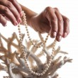 Pearl necklace in hands — Stock Photo #65069971