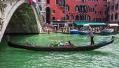 Tourists travel on gondolas at canal — Stock Photo