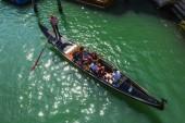 Tourists travel on gondola  in Venice. — Stock Photo