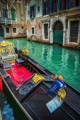 Tourists travel on gondola at canal — Stok fotoğraf