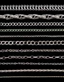 Collection of chains on a black background — Stock Photo