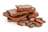 Milk air chocolate with Cocoa beans before roast. — Stock Photo