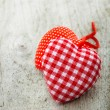Two textile hearts on wooden background — Stock Photo #53243539