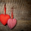 Checkered and polka dots two textile hearts — Stock Photo #53246489