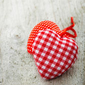 Two textile hearts on wooden background — Stock Photo