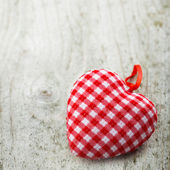 Textile heart on wooden background — Stock Photo