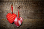 Checkered and polka dots two textile hearts — Stock fotografie