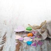 Different color wooden heats near textile bag — ストック写真