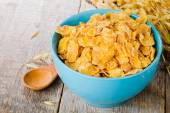 Cornflakes on wooden table — Stock Photo