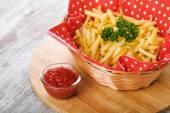 Fries on wooden table — Stok fotoğraf