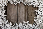 Frame white wooden snowflakes — Stock Photo