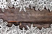 Frame white wooden snowflakes — Stock Photo