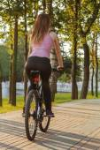 Young woman on bicycle — Stock Photo