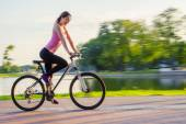 Woman driving on bicycle — Stock Photo