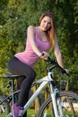 Young woman on bike — Stock Photo