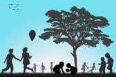Silhouettes of children playing outside — Stock Photo