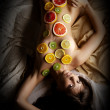 Woman covered with fruits slices — Stock Photo #59795577