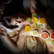 Woman covered with fruits slices — Stock Photo #59795589
