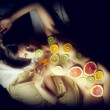 Woman covered with fruits slices — Stock Photo #59795591