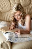 Sexy woman with glasses reading book — Foto de Stock