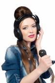 Beautiful girl with a microphone and headphones — Stock Photo