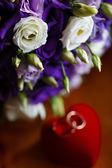Beautiful bridal bouquet of lilies and roses at a wedding party  — Stock Photo