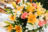 Beautiful bridal bouquet of lilies and roses at a wedding party  — Foto de Stock