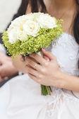 Wedding bunch of flowers in hands of the bride  — Stock Photo