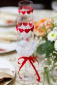 Glasses for drinks and cocktails at the festive table — Stock Photo