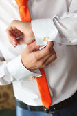 The man clasps a cuff link on a shirt  — Stock Photo