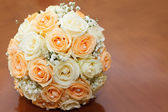 Beautiful bridal bouquet of roses at a wedding party  — Stock Photo