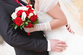 The bride at the wedding is holding a bouquet of flowers  — Foto de Stock
