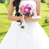 The bride at the wedding is holding a bouquet of flowers — Stock Photo