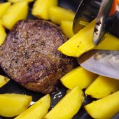 Baked potato with a piece of beef. — Foto de Stock