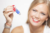 Smiling Woman With USB Memory In Hands — Stock Photo