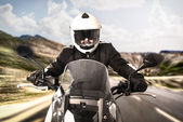 Biker on the road — Stock Photo