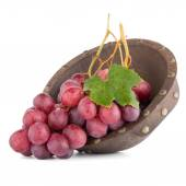 Fresh red grapes in wood bown — Stock Photo