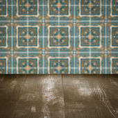 Wood table top and blur vintage ceramic tile pattern wall — Zdjęcie stockowe