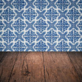 Wood table top and blur vintage ceramic tile pattern wall — Foto de Stock
