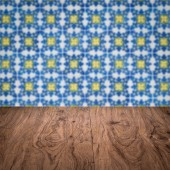 Wood table top and blur  ceramic tile  wall — Foto de Stock