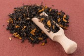 Black Dry Tea with a Wooden Spoon — Stock Photo