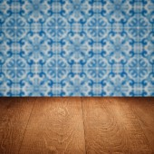 Wood table top and blur  ceramic tile  wall in background — Zdjęcie stockowe