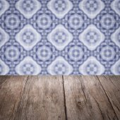 Wood table top and blur vintage ceramic tile pattern wall — Photo