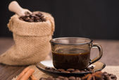 Coffee cup with burlap sack — Stock Photo
