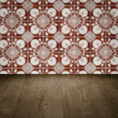 Wood table top and blur vintage ceramic tile pattern wall — Fotografia Stock